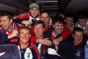 The Inverness players celebrate their victory with manage Steve Paterson on the team bus.