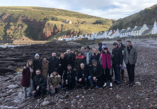 Members of the cast and crew from the Local Hero musical during their visit to Pennan