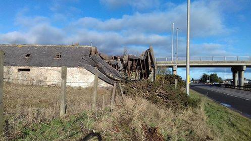 The steading roof has collapsed sparking fears the building might collapse onto the road.