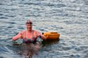 Jennifer Laffan, who is training to cross the Channel in aid of the RNLI, pictured after a 1.1mile swim in Macduff