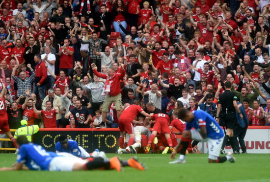 Aberdeen players celebrating after Bruce Anderson equalises at Pittodrie in August 2018. Picture by Darrell Benns.