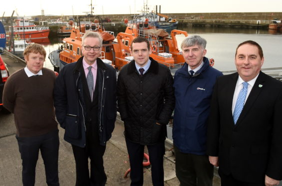 The secretary of state for environment , Food and Rural affairs, Michael Gove visits the Lifeboat station, Buckie. In the picture are from left: Tim Eagle, Michael Gove, Douglas Ross, Doald Gatt and James Allan.