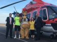 Steve Szalay from Aberdeen Airport, CHC Captain Ryan Broadhurst, Kuddles and Hannah Adams from Befriend a Child, and Mark Abbey from CHC.