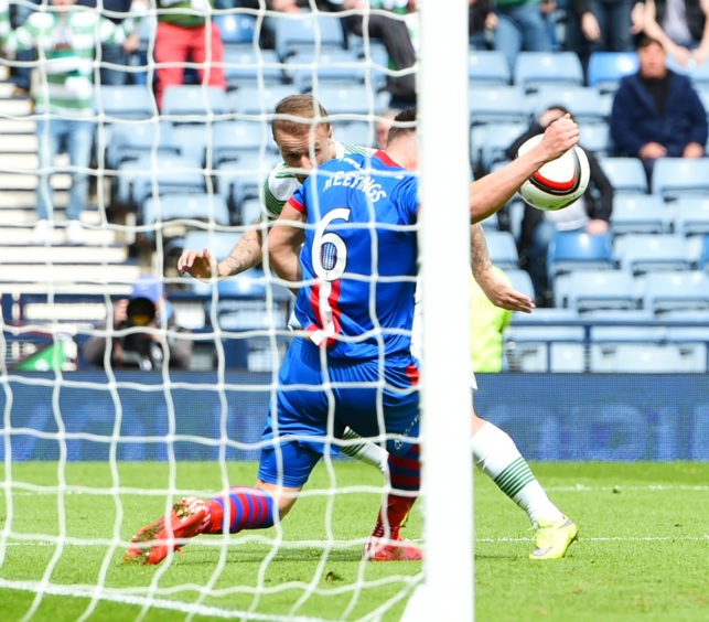 Inverness CT's Josh Meekings (6) appears to handle a header from Leigh Griffiths