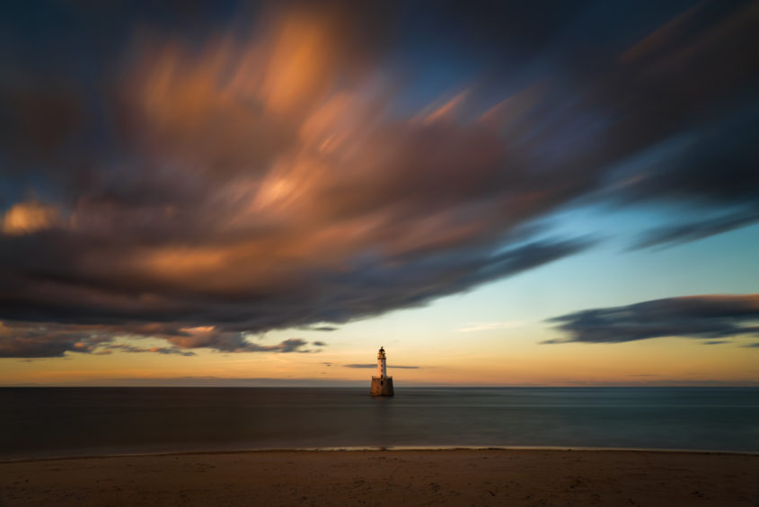 Rattray Head Lighthouse in sunset light, east coast of Scotland
