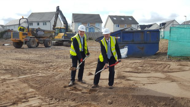 Richard Lochhead MSP and Mike Martin, chairman of Hanover Scotland, begin construction at the site of the former Spynie Hospital in Elgin.