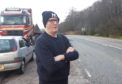 """Phil Walker, near his home on the A82. His car was seriously damaged earlier this month on """"crater"""" near to Glencoe."""
