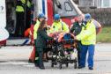 A paraglider pilot was airlifted to hospital after crashing into a hillside. (Derek Ironside/Newsline Media)