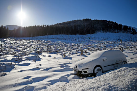 A car abandoned on the  A939 road between Cockbridge and Tomintoul. (Photo by Jeff J Mitchell/Getty Images)