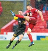 Aberdeen boss Derek McInnes has doubts over Scott McKenna's fitness for Kazakhstan clash
