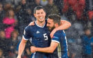 Scotland's Scott McKenna (left) with Aberdeen teammate Graeme Shinnie at full time