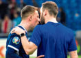 Scotland captain Callum McGregor (L) exchanges words with assistant manager, James McFadden at full time
