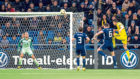 Baktiyar Zainutdinov (R) rises highest to nod home Kazakhstan's third goal of the evening.