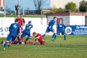 Cove's Jamie Masson's celebrate as he slots home the equaliser