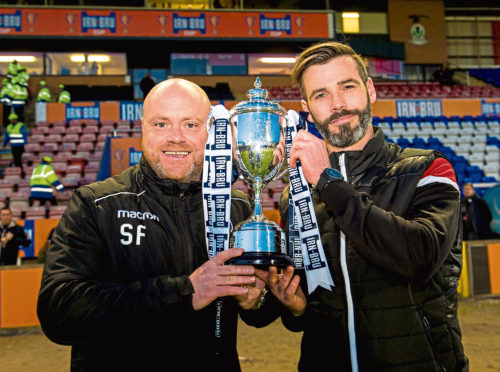 Ross County co-managers Steven Ferguson (L) and Stuart Kettlewell lift the trophy at full-time