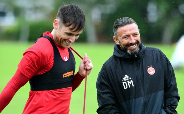 Greg Tansey with his former Aberdeen boss Derek McInnes.