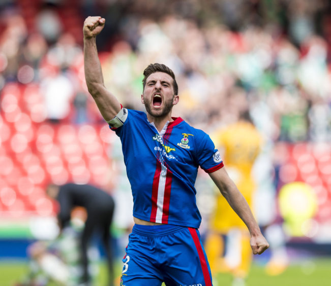 Inverness captain Graeme Shinnie celebrates at full-time.