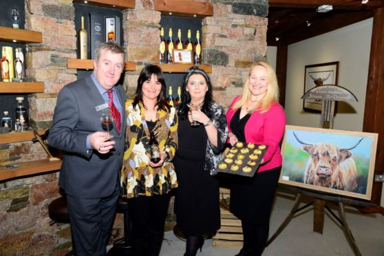 Christopher Harrington of Macdonald Aviemore Hotel; Samantha Faircliff of Cairngorm Brewery and Patricia Dillon and Susan Libeks of Speyside Distillery celebrating the launch of the Aviemore Big Mix Festival