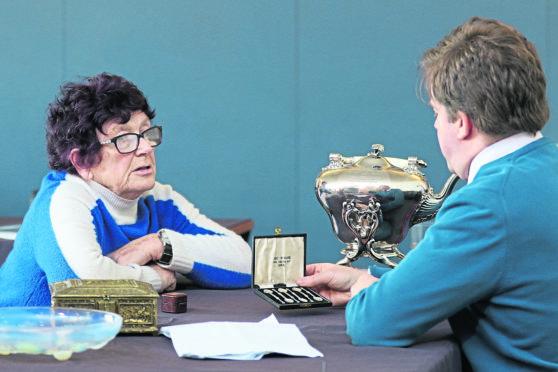 Margaret McInnes from Balloch with Bonhams senior valuer Hamish Wilson, who was valuing a set of Iona Celtic Art spoons.