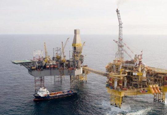 Total's Elgin PUQ platform, pictured right, alongside a Rowan rig.
