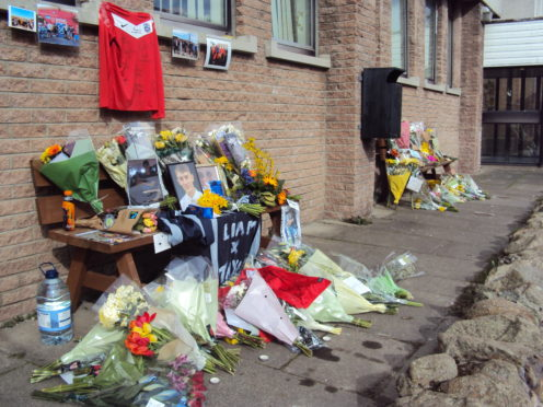 Flowers were piled up in tribute to Liam Smith.