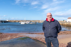 Dennis Slater, Chairman of Hopeman Community Association at Hopeman Harbour