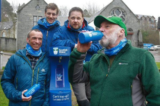 Members of Lochaber Mountain Team joined Cameron McNeish as he drew the first bottle of water from the Fort William Top up Tap.