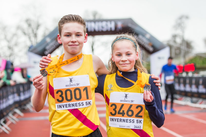Brother and sister Lucas and Anna Cairns win the Inverness 5K.