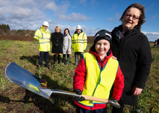 The turf has been cut to start construction on Linkwood Primary School in Elgin. Pictured front: P3 pupils James Kennedy with Sonya Warren, chairwoman of Moray Council's children and young people's committee. Pictured rear: chief executive of Hub North Scotland Michael Padzinski, Moray Council's Head of Schools Vivienne Cross, head teacher Fiona Stevenson, Balfour Beatty's contracts manager Joe Mulligan.