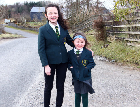 Sophie and Lucy MacGregor at Ardconnel farm where the bus used to pick them up