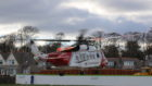 The Inverness coastguard helicopter landing at ARI .