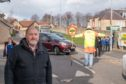 Elgin City South councillor John Divers outside New Elgin Primary School.