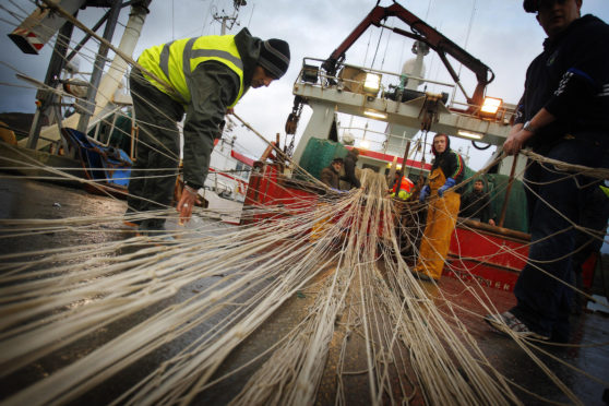 Trawler men working with their nets