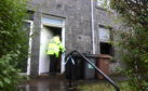 Police at the scene of the fire in Gladstone Place, Woodside, Aberdeen. Picture by Chris Sumner.