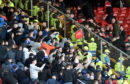 A seat is thrown into the Aberdeen area of fans after full time.
