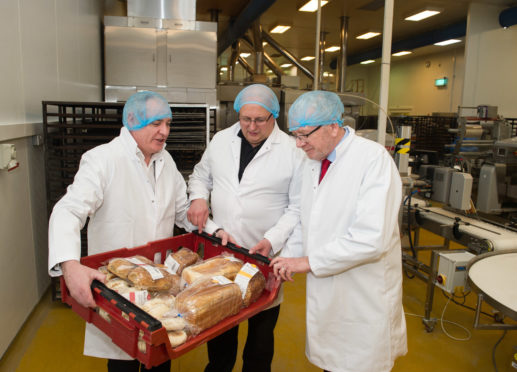 SNP's Cabinet Secretary for Government Business and Constitutional Relations, Michael Russell is pictured visiting Maclean's Highland Bakery in Forres, Moray earlier today.  L2R - MSP Richard Lochhead ,Managing Director Lewis Maclean  and SNP's Cabinet Secretary for Government Business and Constitutional Relations, Michael Russell  Picture: Jason Hedges