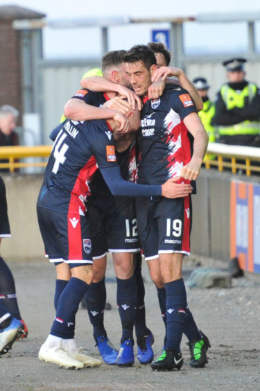 Number 14 Ross County's Josh Mullin scores