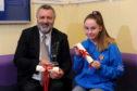 Martin Kasprowicz and Shannah Findlay with their awards.