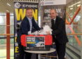 Scott McGinigal and Alan McCabe make the draw for the minibus competition.