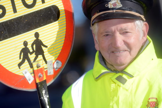 Jim Stewart has been a lollipop man for 20 years. Picture by Kath Flannery.