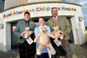 Ballater pipers and heavies have teamed up to donate cuddly toys to sick children.