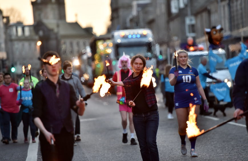 Hundreds line Aberdeen streets as students celebrate 129th Torcher Parade