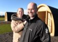 Ewan and Truus McConachie of Kinchyle farm, Nairn on the site of their new caravan and camp site which is set to open in the coming weeks. Picture by Sandy McCook