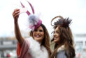 Amy Brown (left) and Jessica Carpenter ahead of Ladies Day.