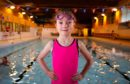 Eight children aged six and seven will collectively swim 200 lengths to raise money for cancer charities including Dee Bradley (pictured).