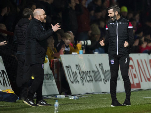 Ross County managers Steven Ferguson (L) and Stuart Kettlewell celebrate at full-time after the win over Ayr United.