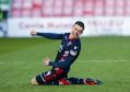 Ross County's Josh Mullin celebrates his goal