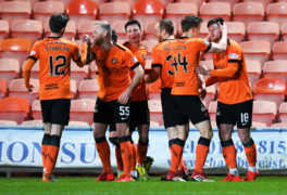 Calum Butcher (R) is congratulated by his teammates after firing Dundee United ahead.