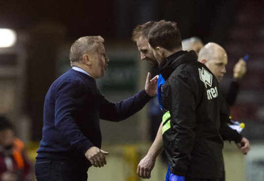 Inverness CT manager John Robertson (L) speaks with Sean Welsh as he leaves the field with an injury