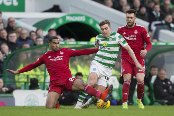 James Forrest is stopped by Aberdeen's Max Lowe.